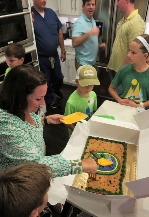 Laura Lawton serves a very special Falling Creek Cookie Cake to the families when she hosted the camp movies and reunion in Winter Park, FL in October 2018