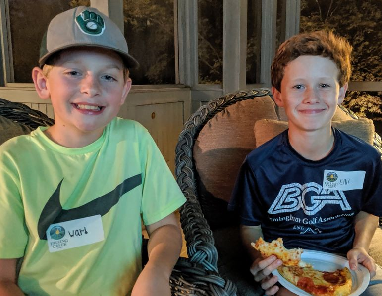 5- Year campers Ward and Ellis catching up over pizza